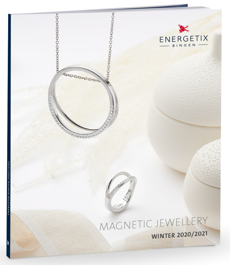 Cover of Magnetic Jewellery winter collection 2020-2021. showing large round ring design pendant with Swarovski crystals hanging on a steel chain necklace, above a matching design ring